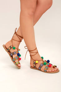 Accalia Whiskey Brown Lace-Up Pompom Sandals at Lulus.com!