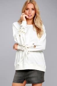 TREND ZONE WHITE GROMMET SLEEVE SWEATER at Lulus.com!