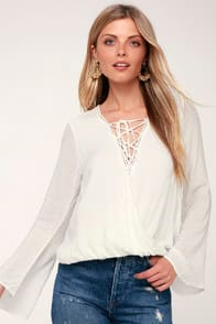 Lulus Morningside White Lace-Up Bell Sleeve Surplice Top at Lulus.com!